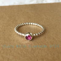 Sterling silver beaded stacking ring with vivid pink tourmaline