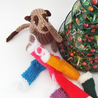 Knitted Meerkat with Christmas stocking