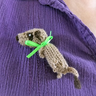 Knitted meerkat brooch, green ribbon, pin on side of meercat