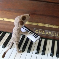Meerkat piano player, pianist, knitted keyboard, musician plush