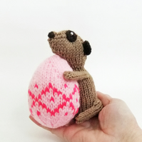 Meerkat with pink Easter egg