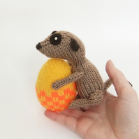 Meerkat with yellow and orange checked Easter egg