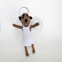 knitted Meerkat angel, wired limbs, to stand or hang on your Christmas tree