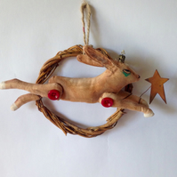 Christmas decoration hare leaping on willow