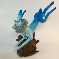 Textile blue hare leaping.