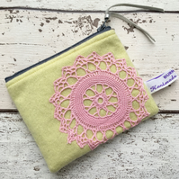 Yellow coin purse with pink vintage doilly