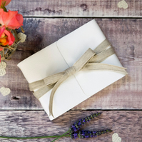 A6 Rustic Wedding Guest Book: Small leather bound with natural linen ribbon.