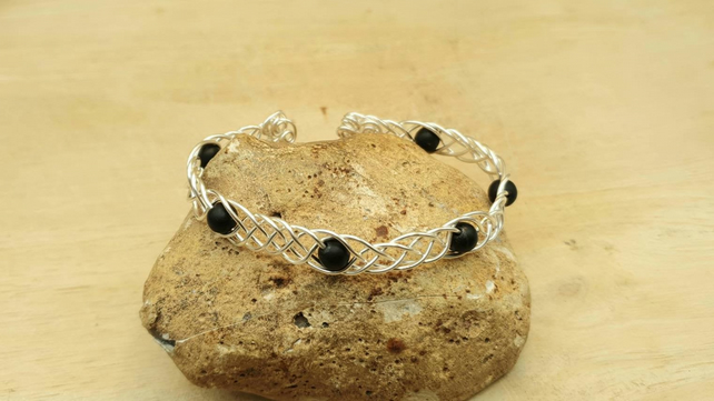 Adjustable Wire wrap Shungite cuff bracelet. Celtic knot weave