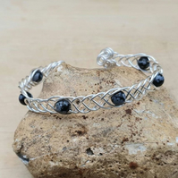 Adjustable Snowflake Obsidian cuff bracelet. Wire wrapped Celtic Weave