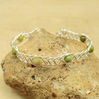 Adjustable Chrysoprase cuff bracelet. May Birthstone Wire wrapped Celtic Weave