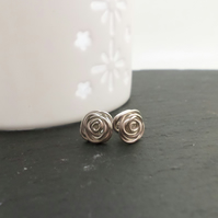 Sterling silver rose shaped stud earrings.