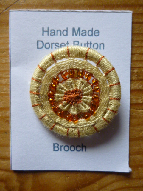 Beaded Dorset Button Brooch, Cream and Orange, B11