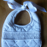 Hand Smocked Special Occasion Baby Bib, White Trimmed with Ribbon Ties