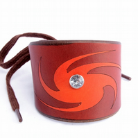 Handmade Leather Cuff With Swirly Design and Large Decorative Rivit.