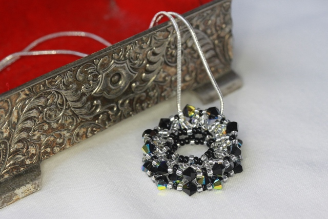 SALE: Black and Silver Beaded Wheel Pendant