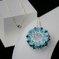 Sparkly Aqua Blue Beaded Wheel Pendant
