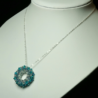 Sterling Silver and Swarovski Indicolite Wheel Pendant