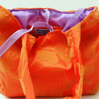 Orange and lilac handbag
