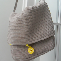 Grey and yellow messenger bag