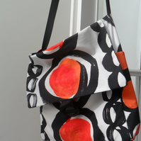 Red, black and white messenger bag