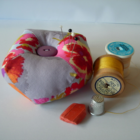 Pincushion - patchwork , biscornu shape in lilac pansy print FREE p&p