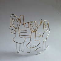 A freestanding Sterling silver family group from a childs drawing