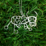 A sterling silver cow pendant from a childs drawing, kids drawing