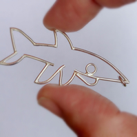A chunky sterling silver shark designed from a child drawing.