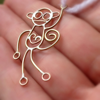Mad monkeys from a childs drawing. Available in sterling silver or 9ct gold.