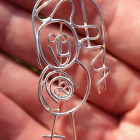 Mum with baby in her tummy. A bespoke Sterling silver brooch from a kids drawing