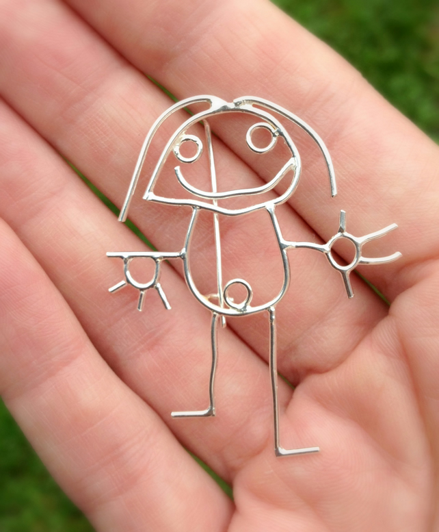 A personalised brooch from a childs drawing made in sterling silver.