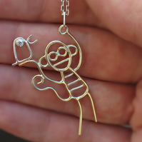 A solid 9ct gold monkey pendant with sterling silver bird