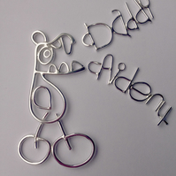 A sterling silver keyring from a childs drawing with 2 childrens writing tags