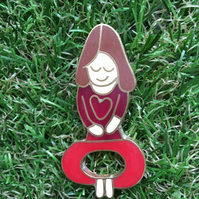 Yoga mummy pin from a childs drawing in resin and metal.