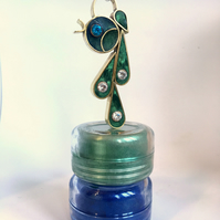 A statement pendant filled with resin enamel and 5 mm cubic zirconia