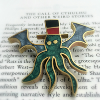 The call of the Cthulhu. A brooch made in resin and metal