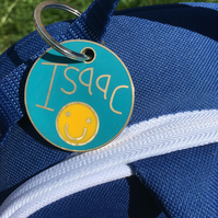 A personalised bag tag in resin and metal