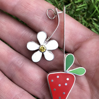 A strawberry flower and strawberry silver pendant with resin and gemstone