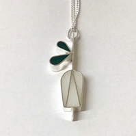 A Snowdrop pendant in silver and resin