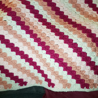 Pinks and cream diagonal stripe crocheted baby blanket