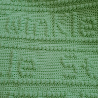 Pale green crocheted baby blanket