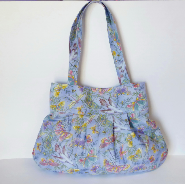Large handbag, shoulder bag.