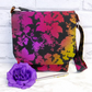 Messenger style handbag, shoulder bag. Multicoloured.