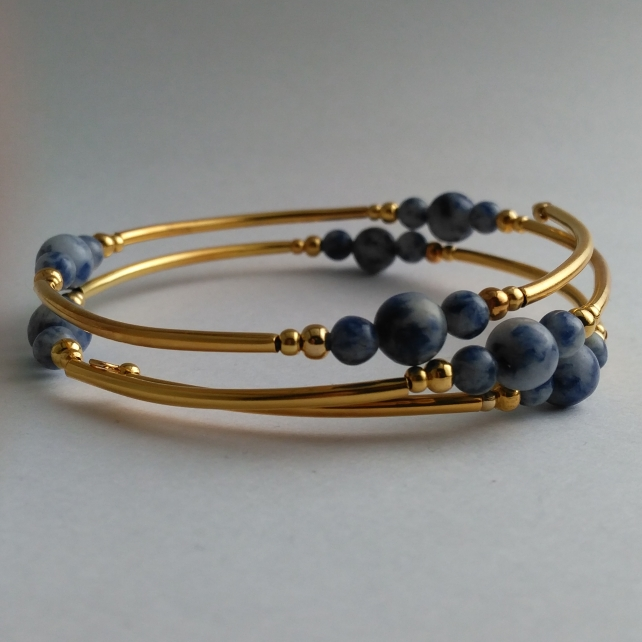 Yellow gold plate and denim lapis or sodalite three strand memory wire bracelet