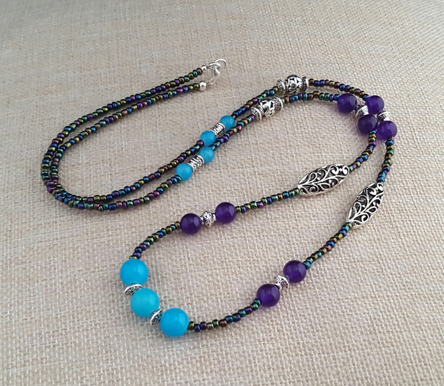 Long iris lustre seed bead necklace with turquoise and purple beads - 1001338
