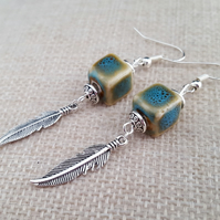 Blue ceramic earrings with Tibetan silver feathers