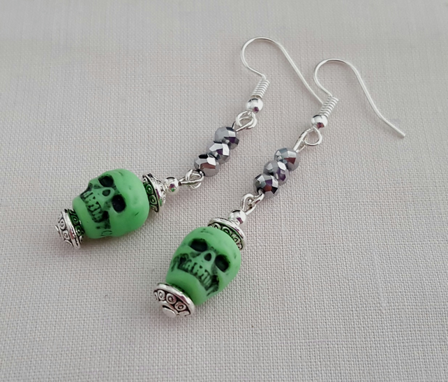 Green and silver skull earrings