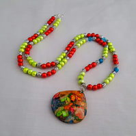 Red, lime green and blue necklace with patchwork agate pendant 1001495
