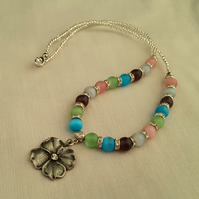 Pastel gemstone bead necklace with silver flower pendant - 1001223