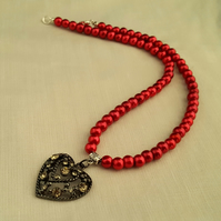 Dark red glass pearl necklace with black heart pendant - 1001679